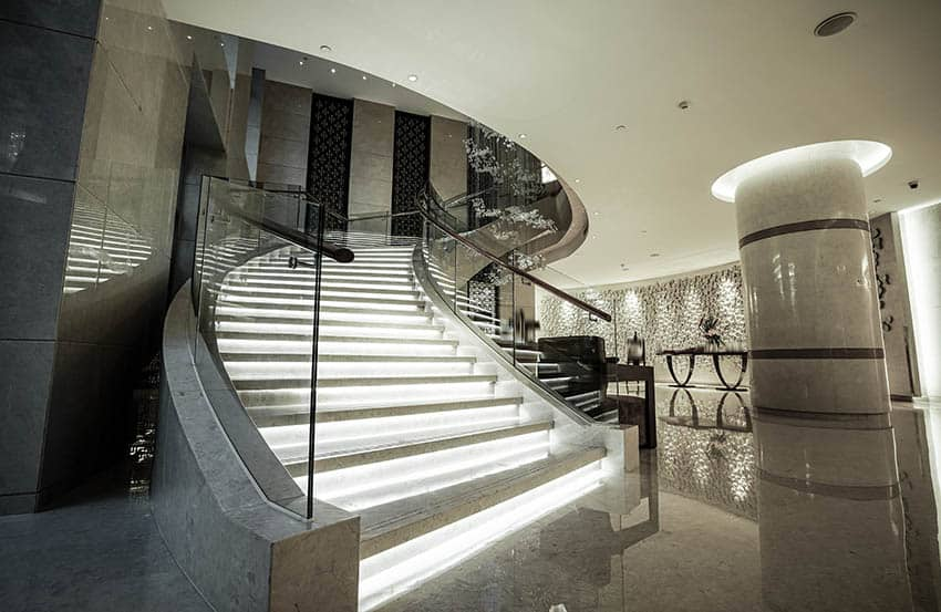 Luxury home with glass walled staircase and lighted steps
