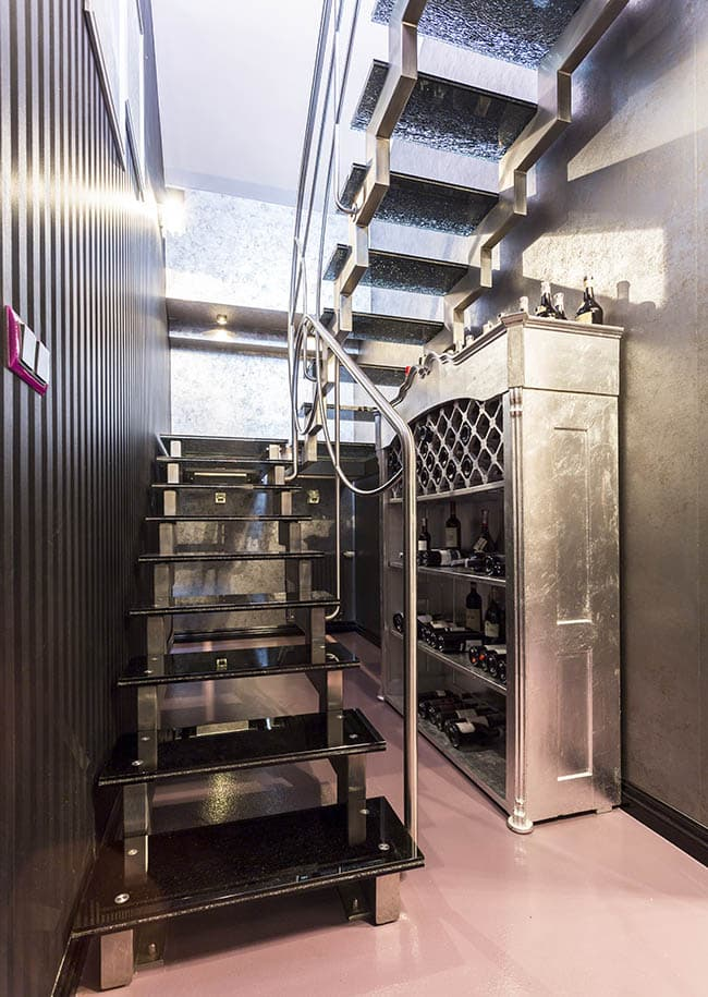 Metal floating switchback staircase with chrome hand rails