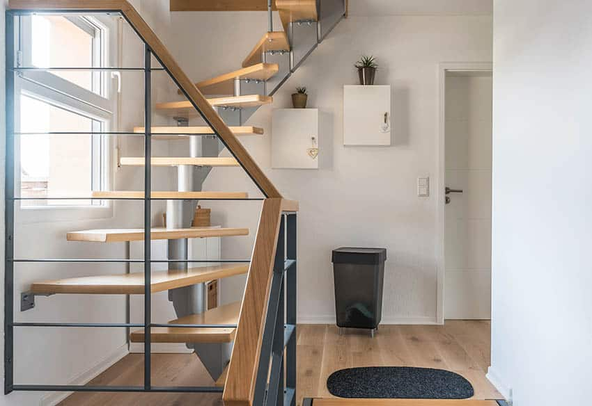 Modern floating spiral stairs with wood steps