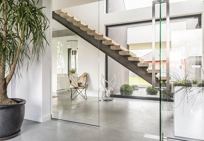 Modern floating stairs with reclaimed wood steps