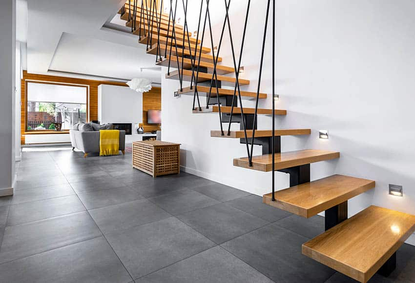 Modern floating stairs with wood steps and vertical cable supports