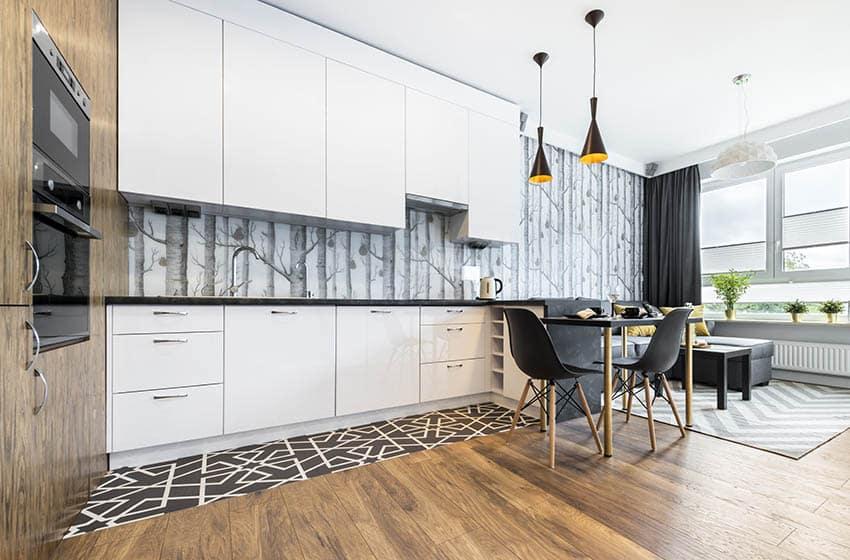 Modern kitchen with wallpaper backsplash white cabinets wood flooring