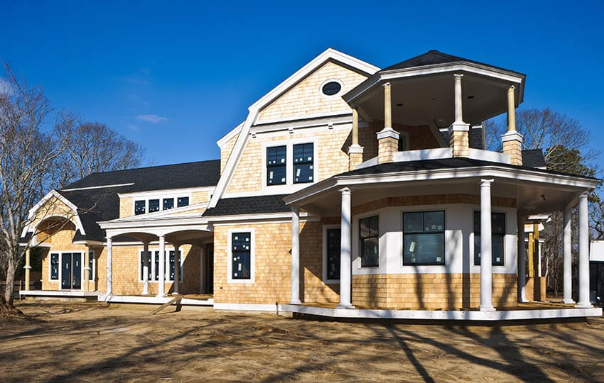 New construction Cape Cod shingle style house