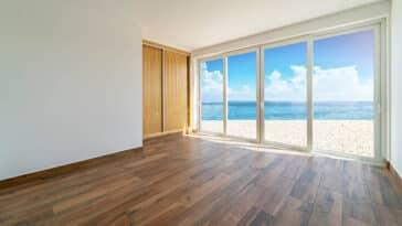 Ocean view bedroom with wood strip pattern flooring design