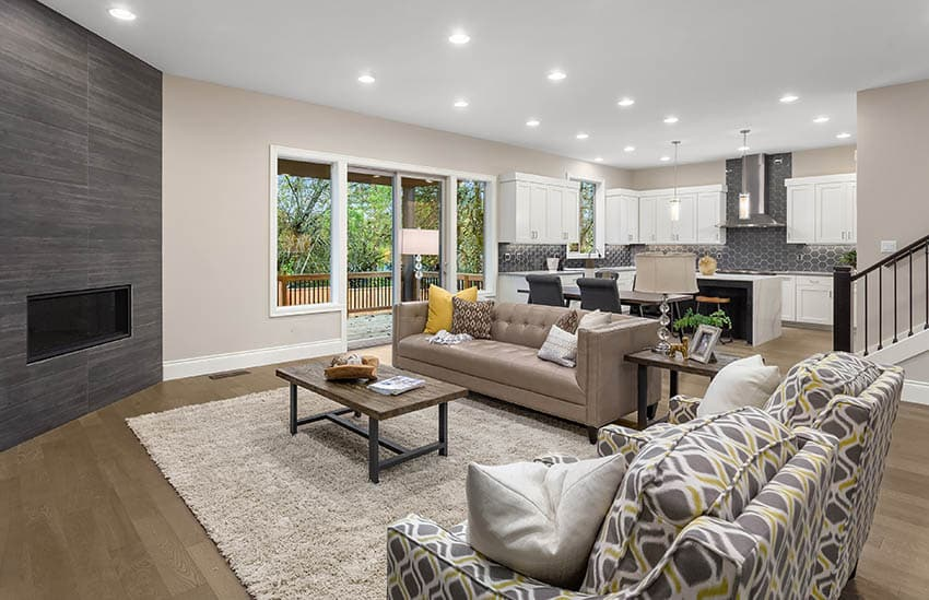 Open concept living room with greige paint wood flooring