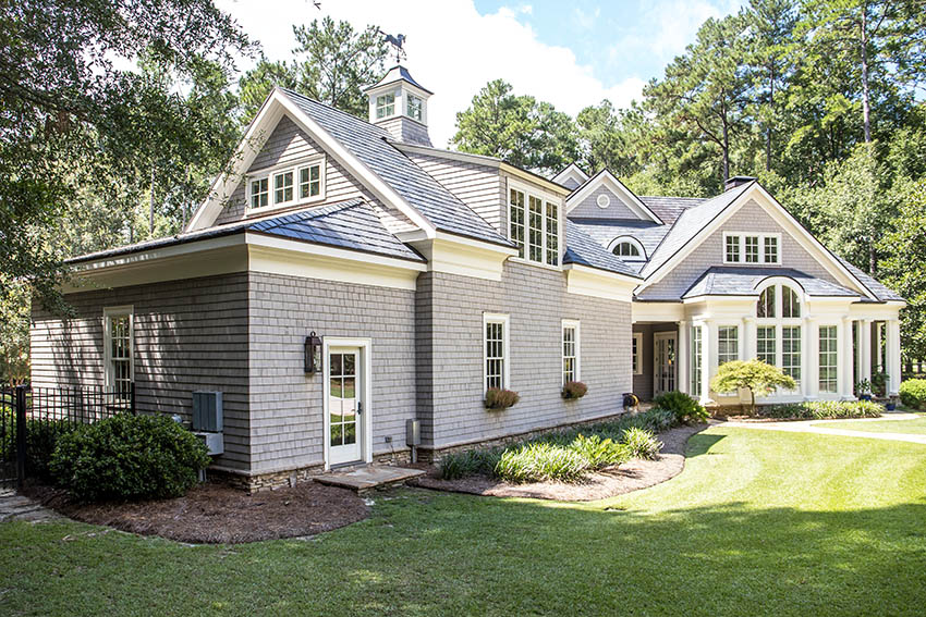 Shingle style house with roof dormers