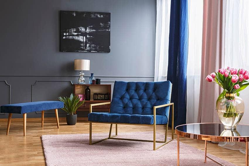 Slate gray paint living room with light wood flooring