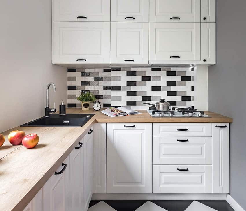Small kitchen with modern peel stick backsplash over stovetop