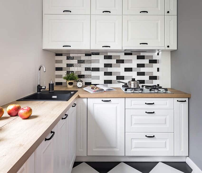 Small kitchen with modern peel and stick backsplash over stove top
