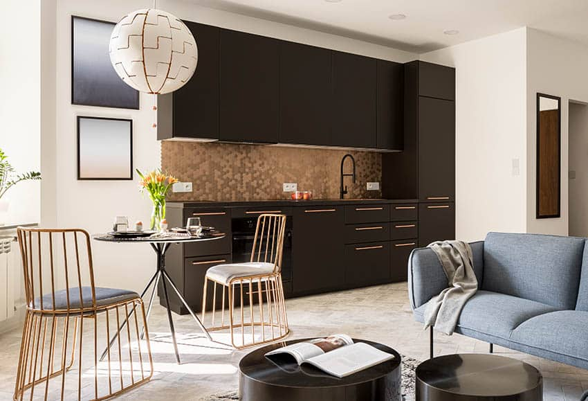 small modern kitchen with gold hexagon peel and stick backsplash