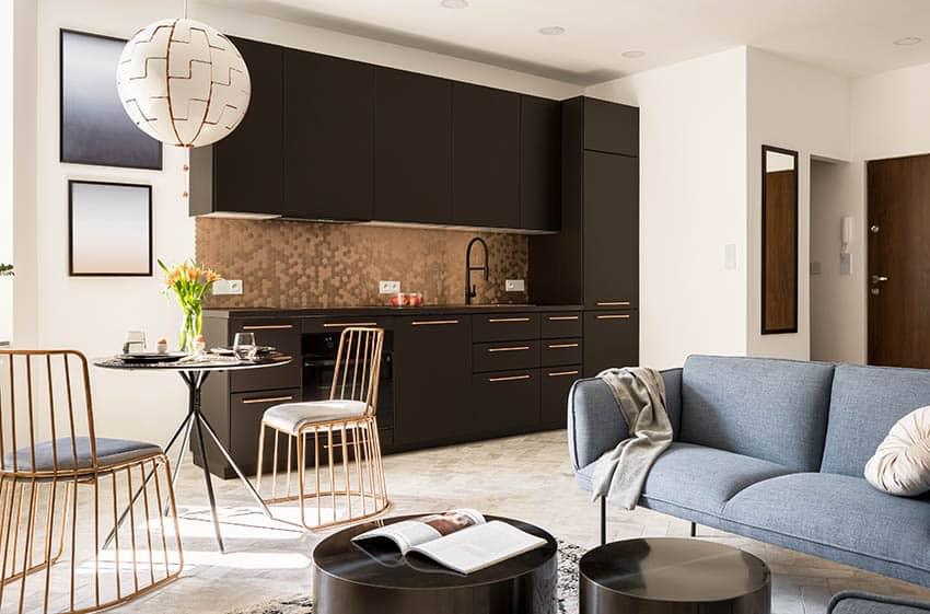 Small modern kitchen with gold metal hexagon backsplash