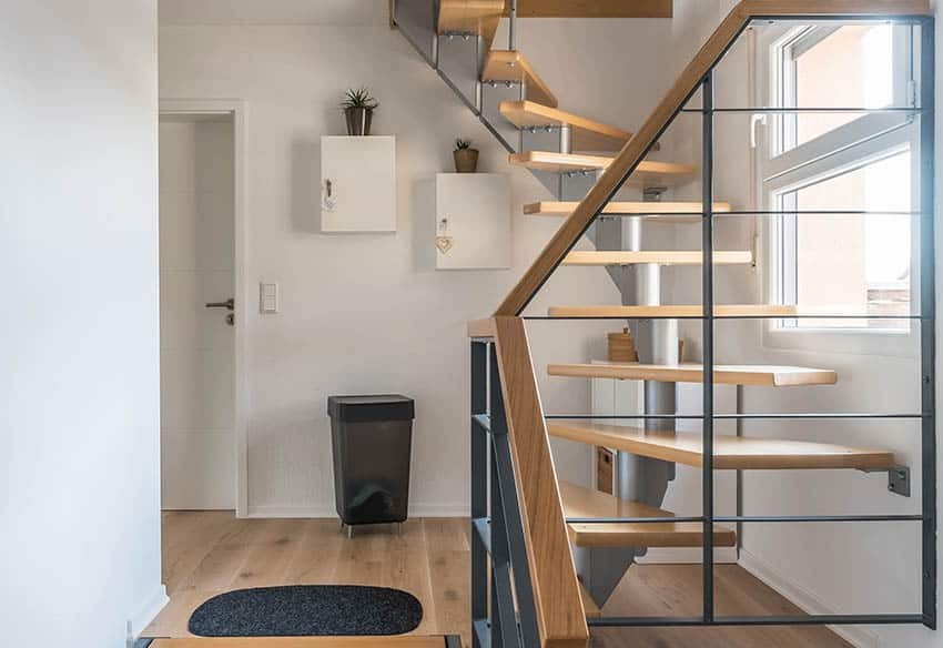 Space saving spiral staircase with wood steps