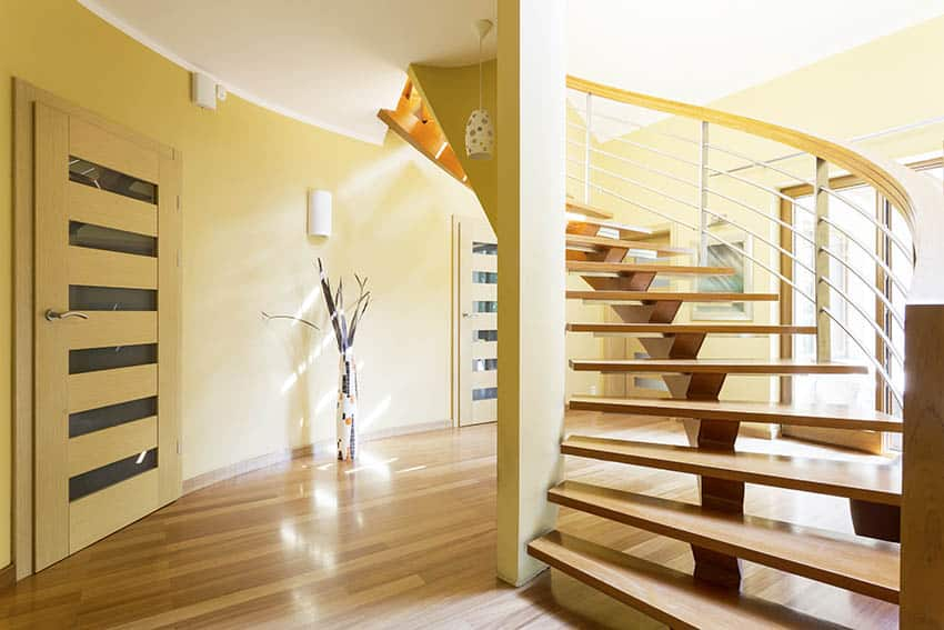 Spiral floating staircase with metal central support spine