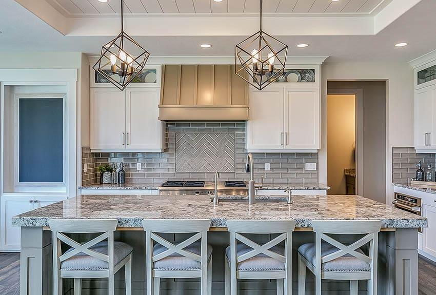 Transitional kitchen with grey subway tile backsplash white cabinets grey island