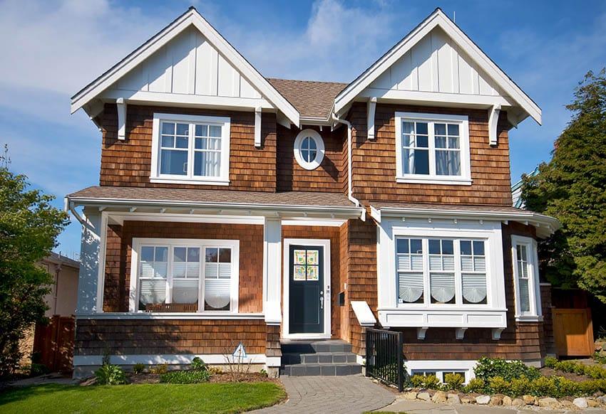 Wood shingle style house with white trim