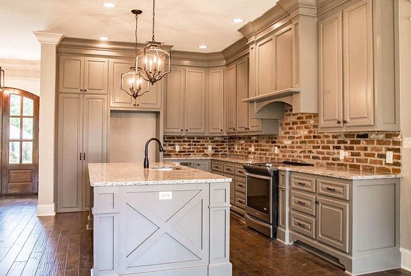 Acadian style house kitchen interior with brick backsplash