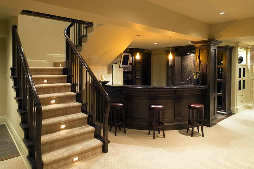 Basement home bar with curved wood countertop bar stools
