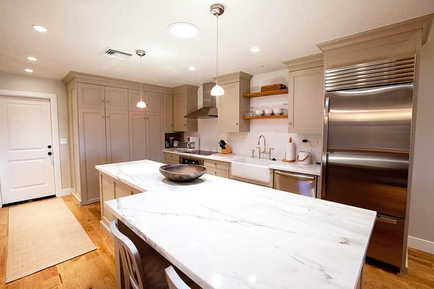 Basement kitchen design with quartz countertop island recessed and pendant lighting