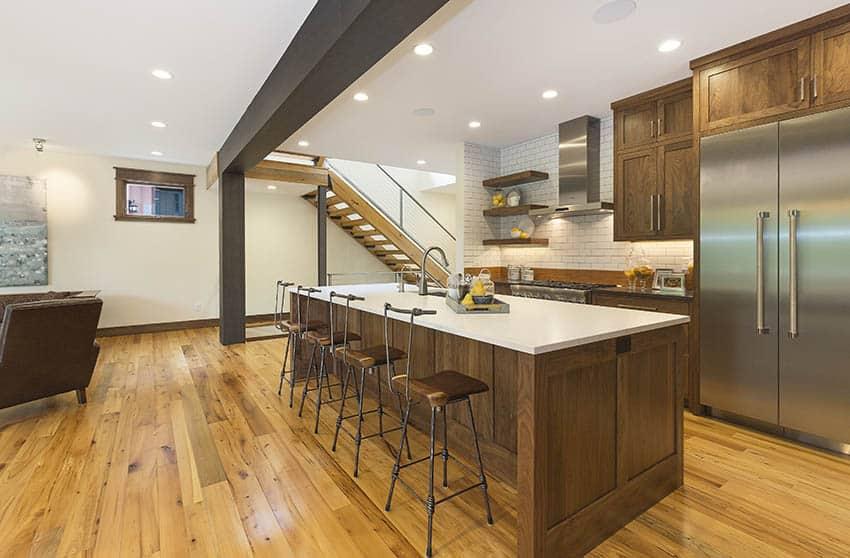 Basement kitchen with large island quartz countertops wood cabinets