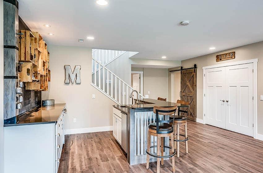 Basement wet bar kitchen with corrugated island wood flooring