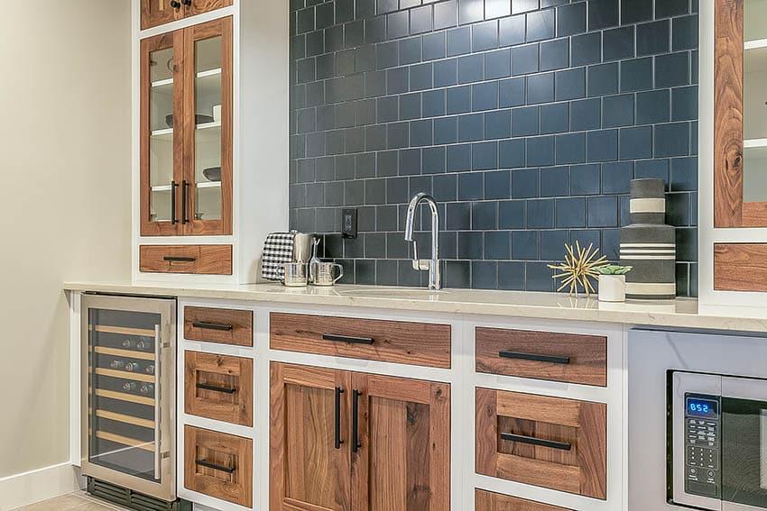 Basement wet bar with storage cabinets quartz countertops black tile backsplash