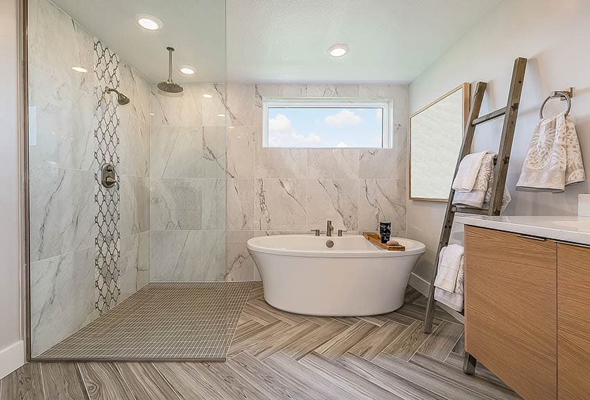 Bathroom with walk in shower freestanding tub and transom window