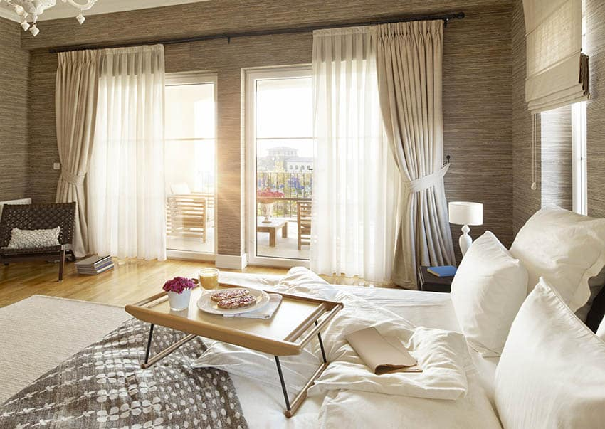 Beautiful bedroom with linen window curtains