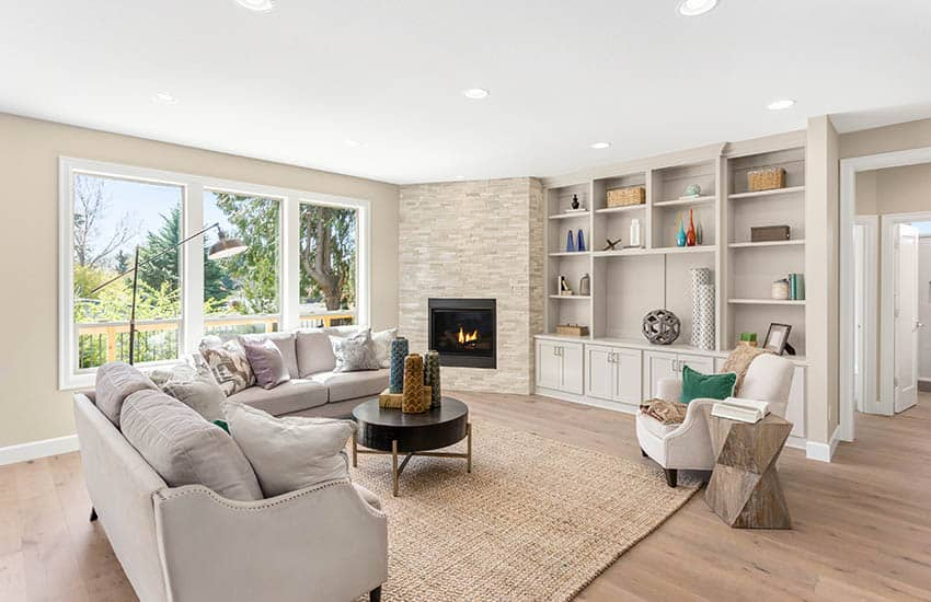 Contemporary living room with engineered wood floors beige wall paint