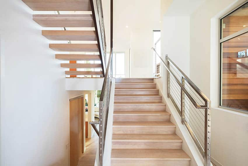 Contemporary stairs with stainless steel railing with cable supports