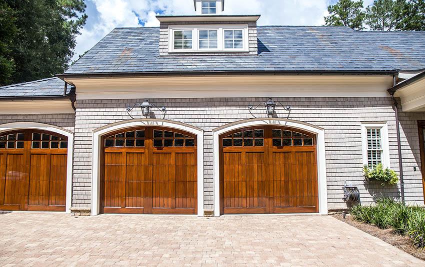 Custom 3 car garage with wood doors