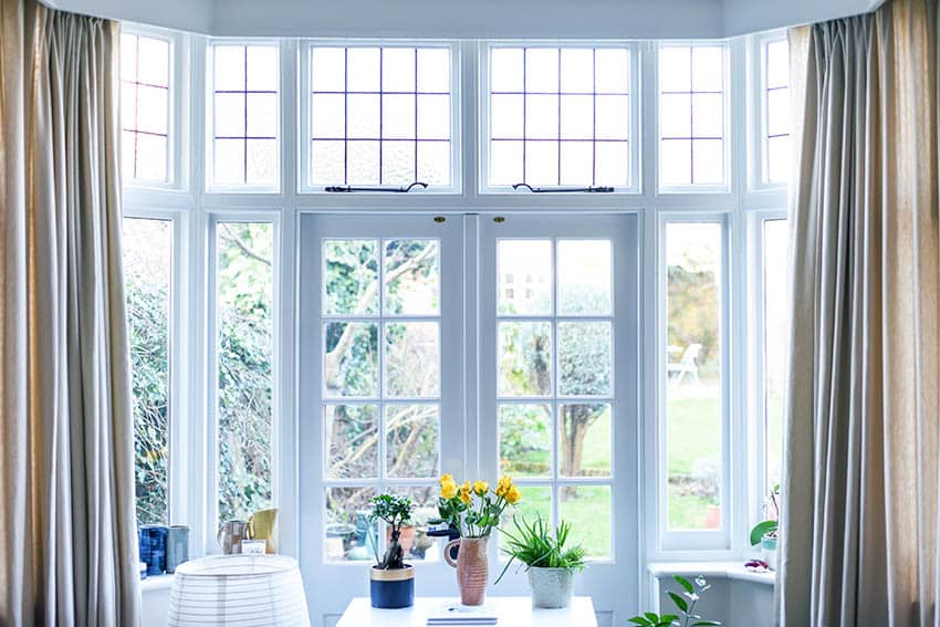 Decorative transom windows with curtains
