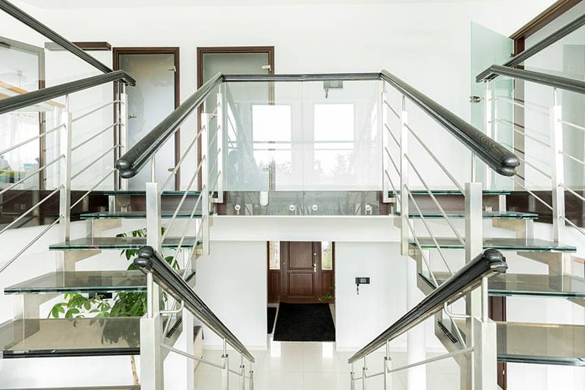 Double glass staircase with wood railing