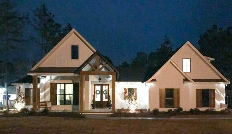 French country home plan at night