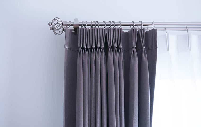 Gray window curtain with decorative rod