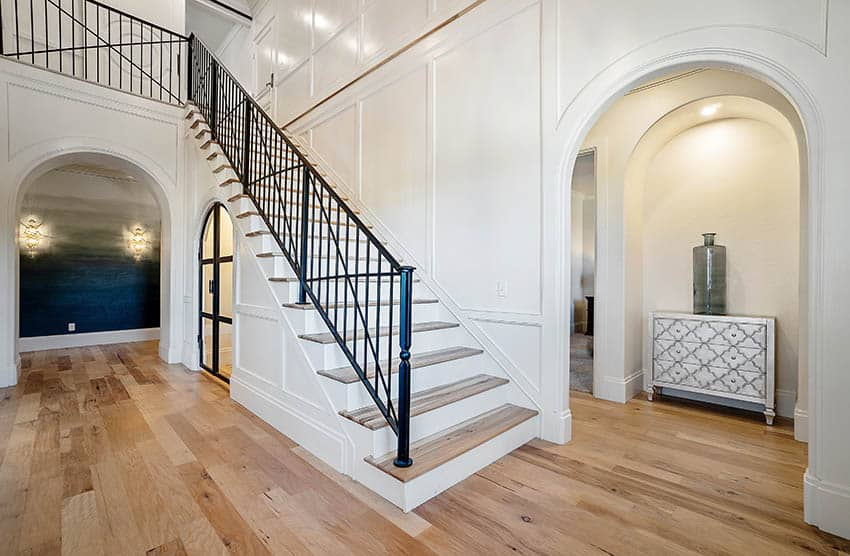 House entryway with staircase metal hand rail