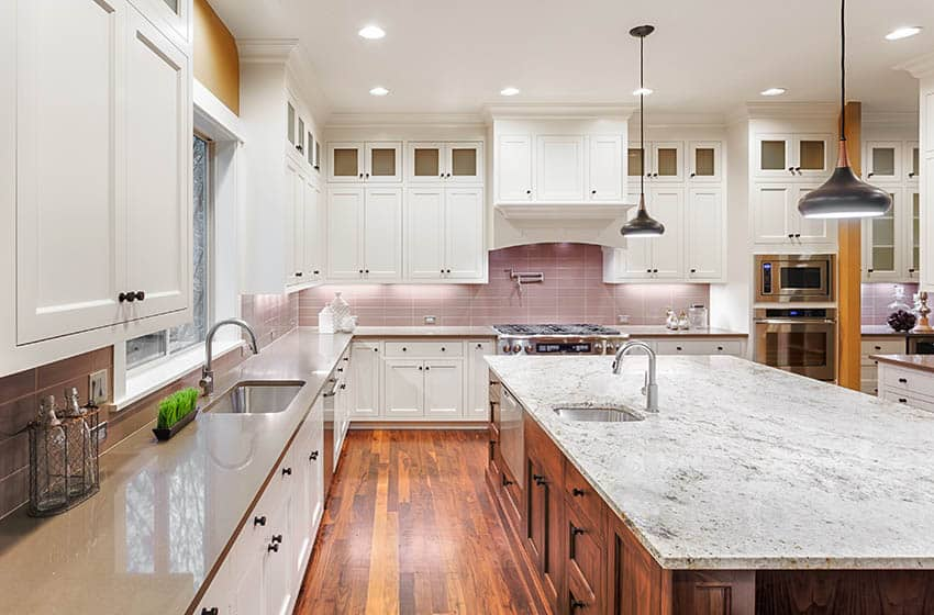 Kitchen with cabinet knobs two tone cabinets gray quartz marble countertops