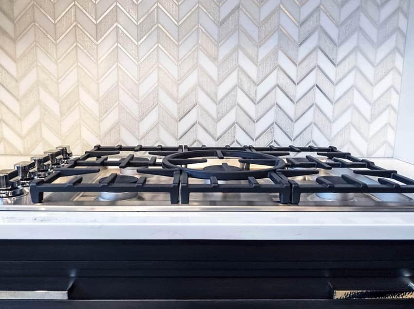 Kitchen with chevron design tile backsplash