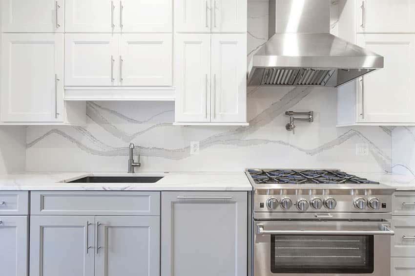Kitchen with full height quartz backsplash
