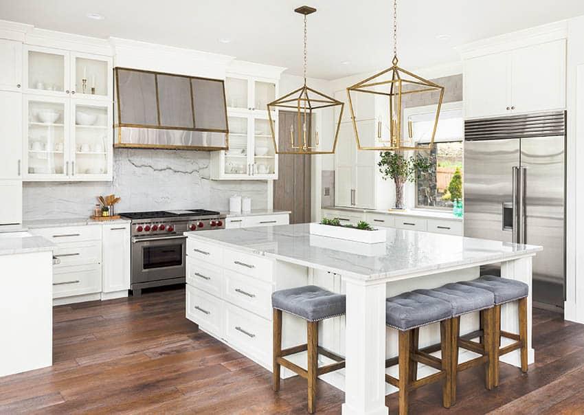 Kitchen with full slab marble style quartz backsplash matching countertop island