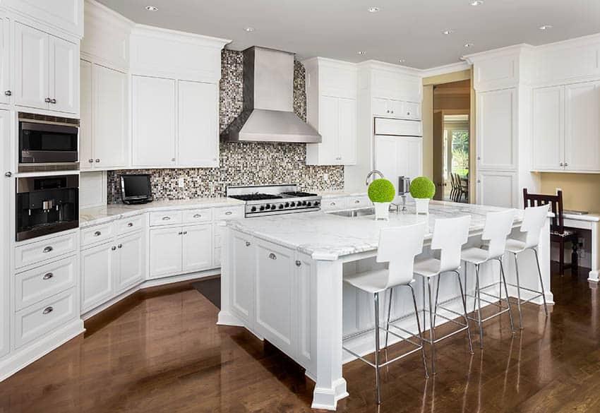 Kitchen with mosaic tile backsplash white cabinets
