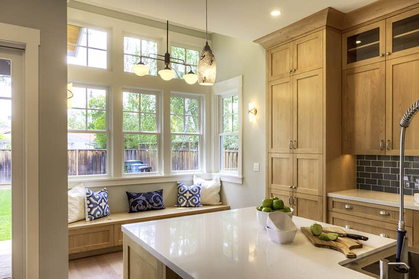 Kitchen with traditional transom windows window seat