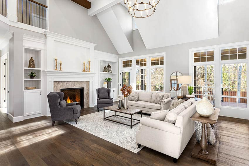 Large living room with engineered wood flooring high ceilings fireplace