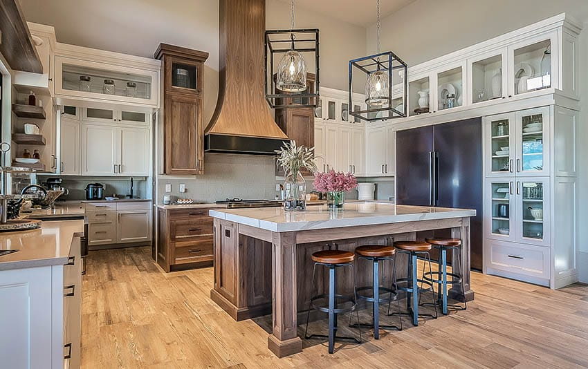 Large modern farmhouse kitchen design, solid wood island, oven hood, shaker cabinets and beige paint