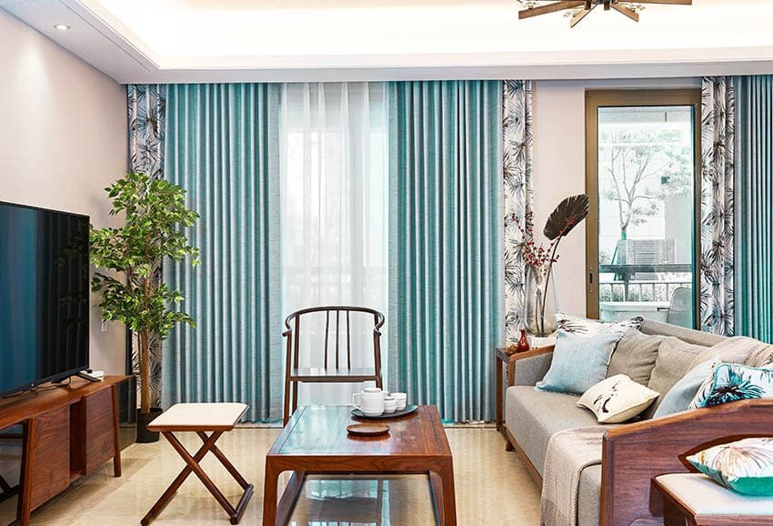 Living room with blue cotton curtains