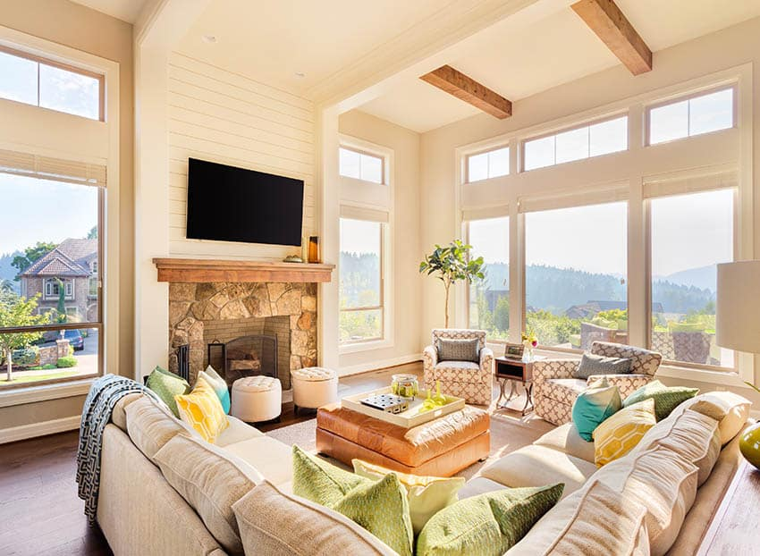 Living room with modern transom windows wood beams
