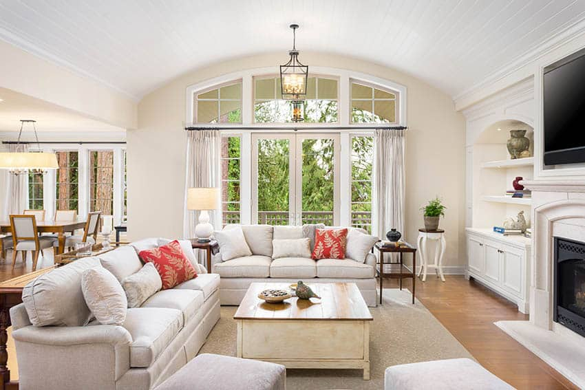 Living room with transom windows arched white shiplap ceiling