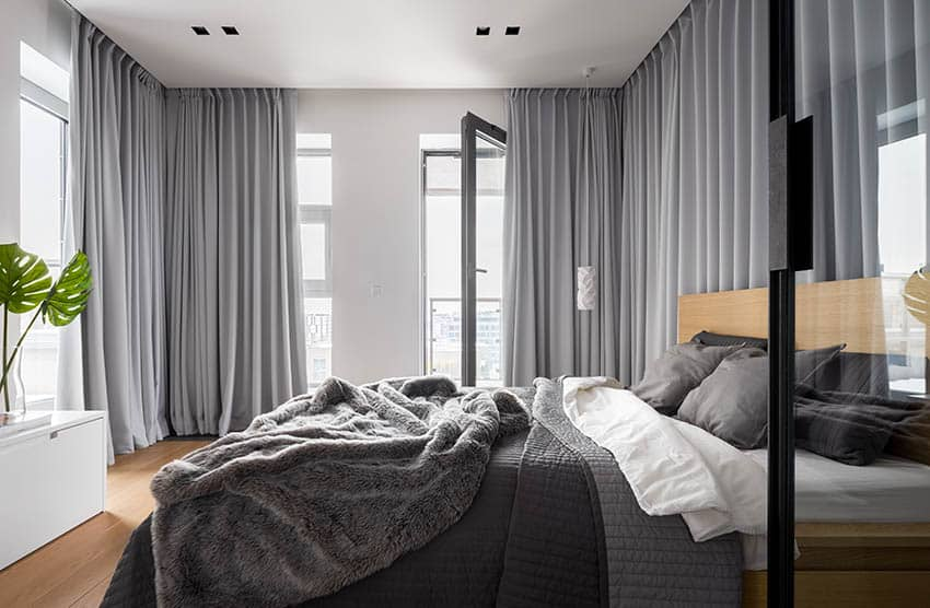 Modern bedroom with wraparound gray curtains