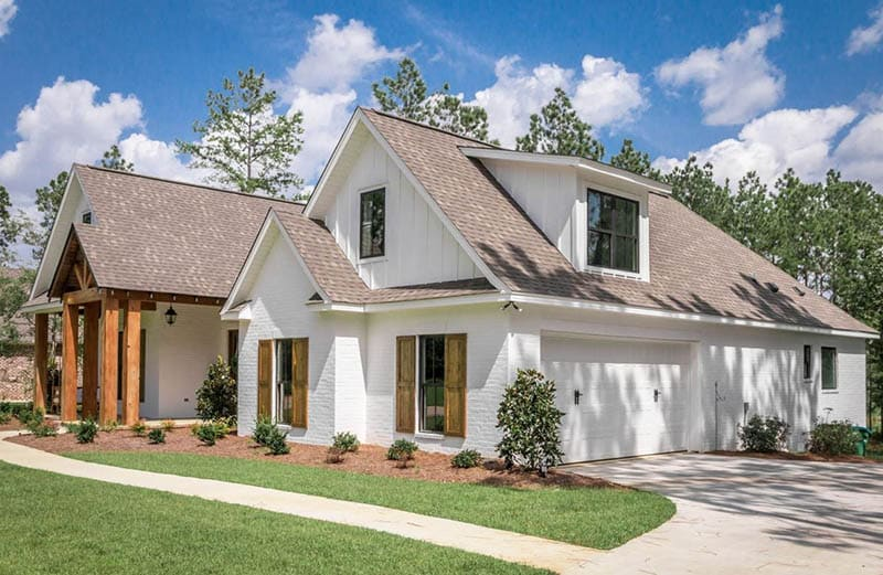 Modern french country home plan with garage
