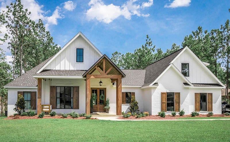 Modern french country house plan front exterior with wood beams porch swing