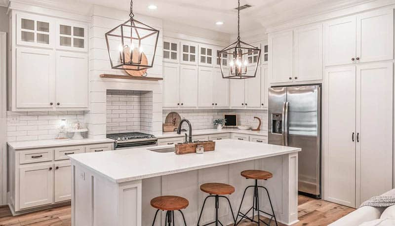 Modern french country kitchen with white cabinets countertops subway tile shiplap oven hood